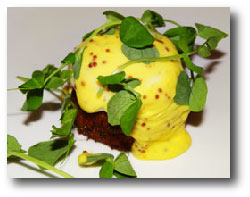 Savannah style crab cake, poached farm egg, dijon sauce, pea greens